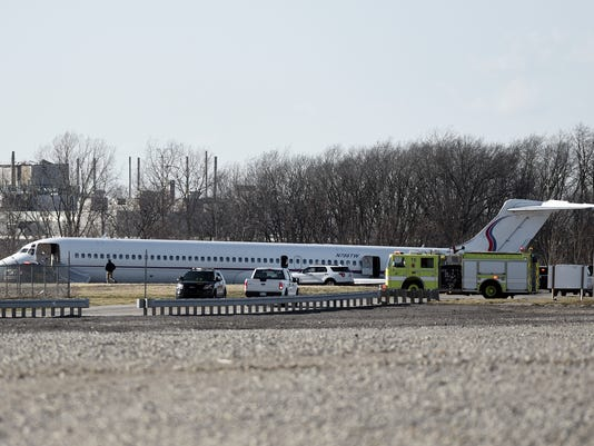 Emergency personnel examine a charter plane that was carrying members of the University of Michigan men's basketball team that was involved in an accident at Willow Run Airport, Wednesday, March 8, 2017, in Ypsilanti, Mich. The plane slid off a runway during an aborted takeoff in high winds, causing extensive damage to the aircraft. The team said everyone aboard was safe. Michigan faces Illinois in the Big Ten conference tournament on Thursday in Washington, D.C. (Melanie Maxwell/The Ann Arbor News via AP)