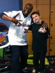 A York Revolution player poses with Zach Foller after surprising him for his 13th birthday. Foller, a sixth grader at Dover Elementary School, was recently diagnosed with autism.