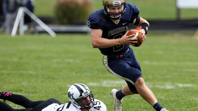 Dan Gilligan (45) of Toms River East misses the tackle on Jake Curry (2) of Freehold Boro during football game at Freehold Boro High School, Freehold ,NJ. Saturday, October 24, 2015. Noah K. Murray-Special for the Asbury Park Press ASB 1025 FreeHold