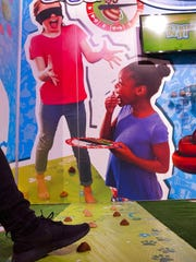 Don't Step In It from Hasbro is displayed at the Toy Fair in New York on Tuesday, Feb. 20, 2018. Players place mounds of brown compound on the game mat, then take turns spinning the spinner to find out how many steps to take across the mat while blindfolded.