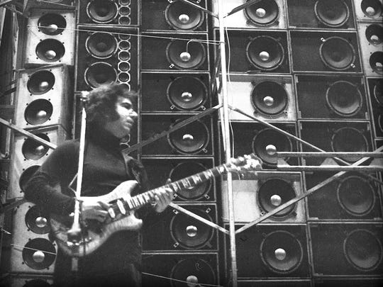 Jerry Garcia, pictured by photographer Peter Simon performing during the Grateful Dead's first concert with the Wall of Sound on March 23, 1974 at the Cow Palace in Daly City, California.
