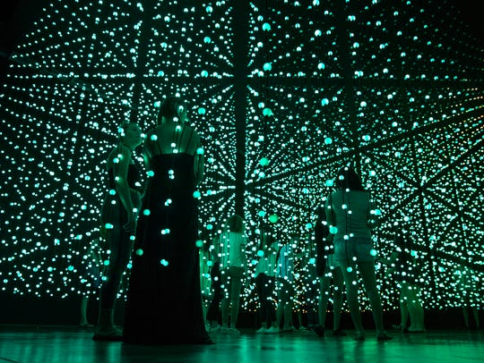 Visitors experience the Ocean of Light exhibit at the