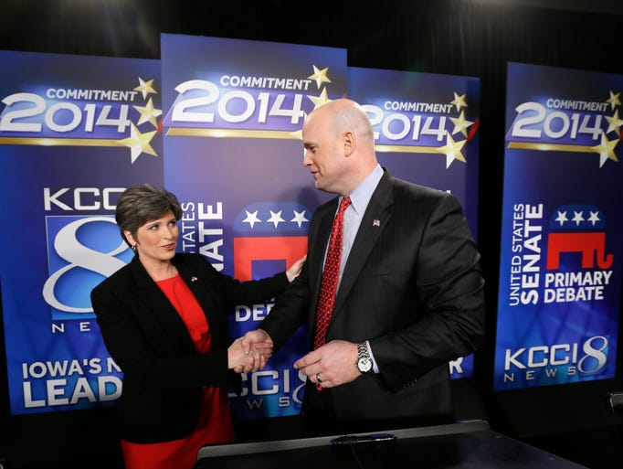 Iowa Republican senatorial candidates, State Sen. Joni Ernst, left, and former U.S. Attorney Matt Whitaker, shake hands after a live televised debate at KCCI-TV studios, Thursday, May 29, 2014, in Des Moines, Iowa.