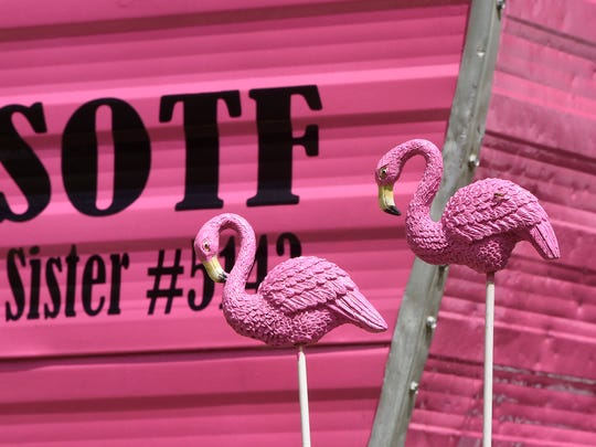 Pink flamingos are part of Sue Notch's decorations outside her 1965 Pathfinder camper.