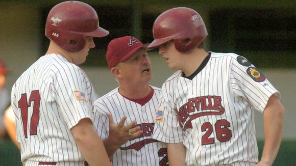 Former Owen/Asheville American Legion Post 70 baseball coach J.D. Hinson, middle.