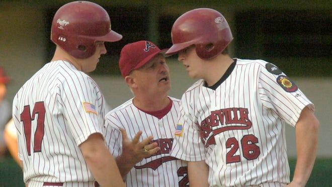 Former Owen/Asheville American Legion Post 70 baseball coach J.D. Hinson, middle.