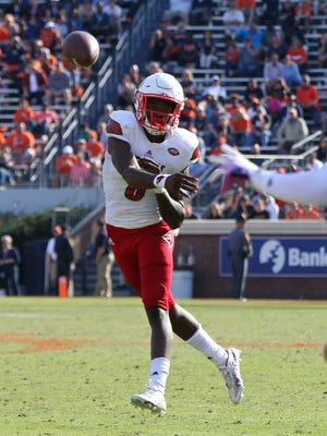 Louisville Cardinals quarterback Lamar Jackson (8) throws the ball to Cardinals tight end Micky Crum (83) against the Virginia Cavaliers in the fourth quarter at Scott Stadium. The Cardinals won 32-25.