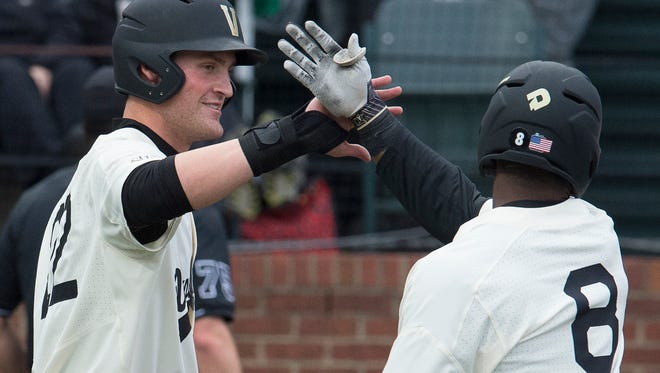 Vanderbilt first baseman Julian Infante (22) congratulates designated hitter Alonzo Jones (8) after he scored off of Jones' sacrifice fly during their game against  Evansville at Hawkins Field Wednesday, Feb. 22, 2017 in Nashville, Tenn.