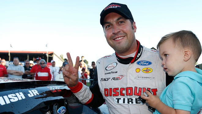 Sam Hornish Jr. celebrates in victory lane after winning the Xfinity Series race at Mid-Ohio Sports Car Course.