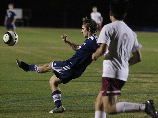 Maclay defender Jared Pichard clears a ball against Florida High.