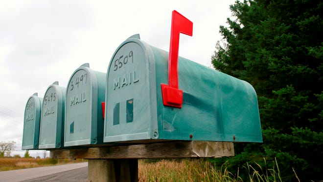 Four rural mailboxes.