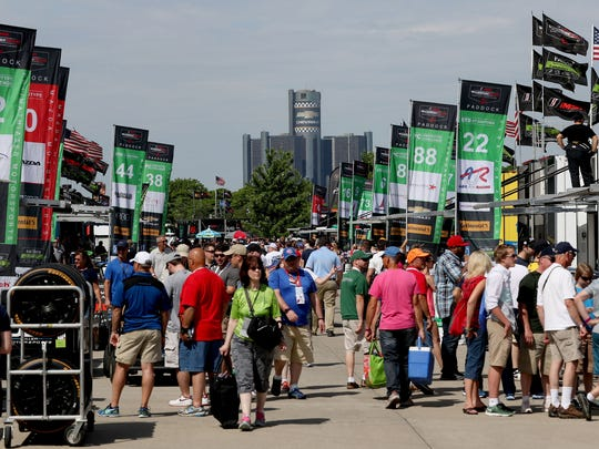 IndyCar and IMSA fans walk around the paddock area during the Chevrolet Detroit Belle Isle Grand Prix in Detroit on Saturday, June 4, 2016.
