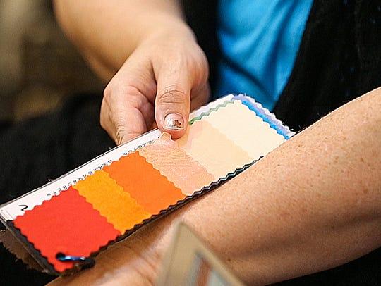 Client Julie Shaw looks at a color palette against
