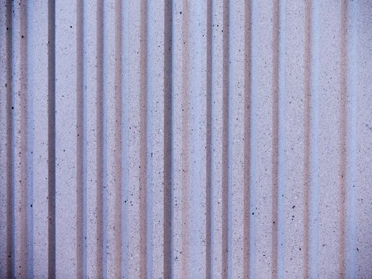 A ribbed pre-fabricated concrete panel, providing sound