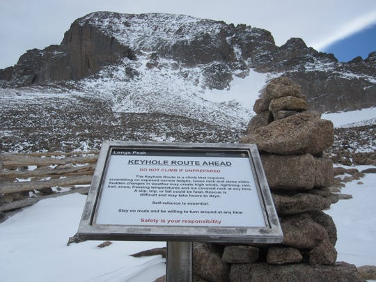A sign at the Boulder Field on Longs Peak warns hikers and climbers of the dangers of trying to reach the 14,259-foot summit.