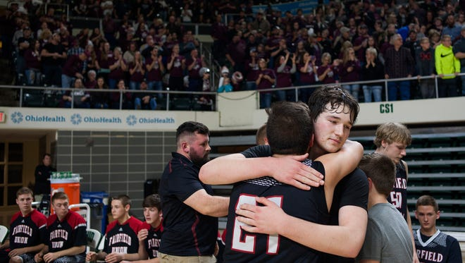 Fairfield Union's Lucas Thompson (10) hugs a teammate after losing to the Vinton County Vikings at the Convocation Center in Athens, Ohio on Friday night.