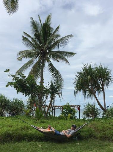 Derek and Walker Hughey relax in a hammock in Ko Lanta, Thailand.
