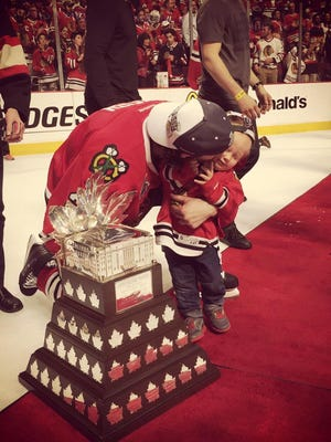 Duncan Keith and his son celebrate.