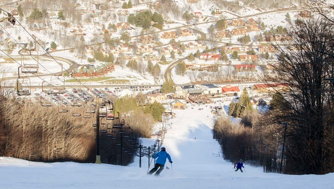 Skiers head down Iliad at Greek Peak Mountain Resort on Sunday, January 1, 2017.