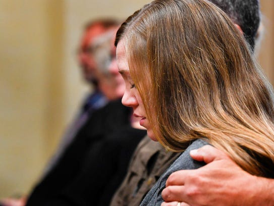 Lisa Baker is comforted by Deputy Kenny Monzon as the