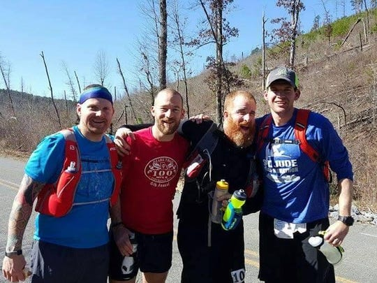 Rusty Harvey, left, is shown with running mates Jake Anderson, Ben Mansur and Brandon Allen at the LOViT 100-mile race at Lake Ouachita.