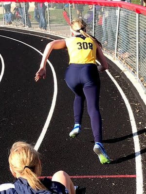 River Valley senior Erika Hyre starts the 4x200 relay for the Vikings en route to a second-place finish at the Friday Night Invitational at Harding Stadium.