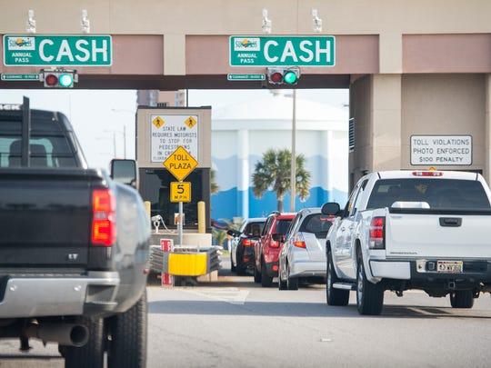 Cars make their way through the Bob Sikes Bridge toll plaza on Pensacola Beach in this file photo.