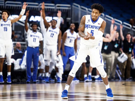 The Memphis bench celebrates guard Kareem Brewton Jr. (right) made three-pointer against USF during first half action of their AAC first round conference tournament game in Orlando, Fl., Thursday, March 8, 2018.