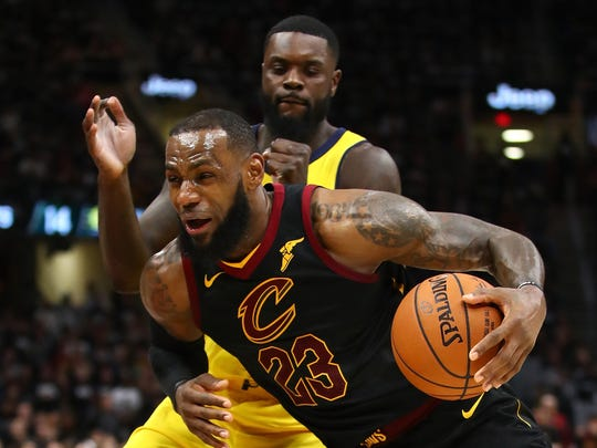 CLEVELAND, OH - LeBron James drives past Lance Stephenson during the second half in Game One of the Eastern Conference Quarterfinals during the 2018 NBA Playoffs.