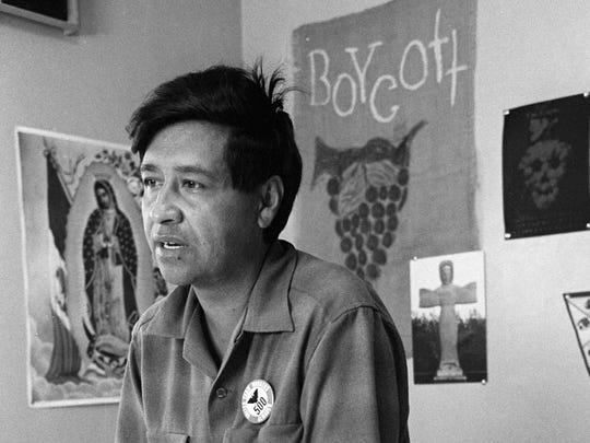 Cesar Chavez, farmworker labor organizer and leader of the California grape strike, works from an office in a file photo from 1965.