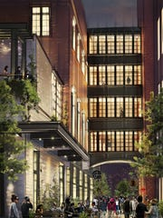 Rendering shows alley view of planned Shinola Hotel and its connection to nearby structure.
