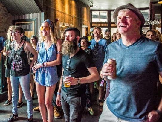 Fountain Square Music Festival attendees catch Bigfoot