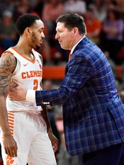 Clemson head coach Brad Brownell talks to Clemson guard Marcquise Reed (2) during their game against Georgia Tech on Saturday, Feb. 24, 2018 at Clemson's Littlejohn Colosseum.