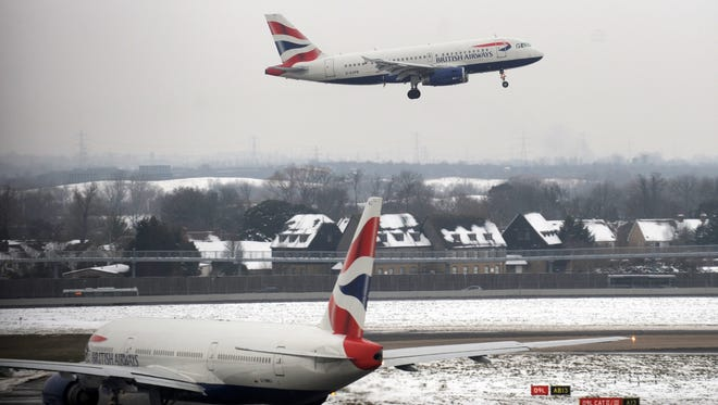 A file photograph showing British Airways aircraft at Heathrow Airport in London, Britain, Dec. 21, 2010.