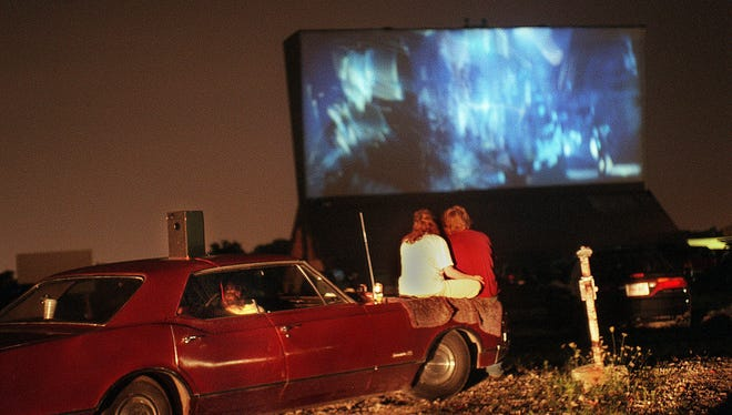 A couple watch a movie at the Highway 41 Twin Outdoor Theatre in Franklin on Aug. 30, 1998.