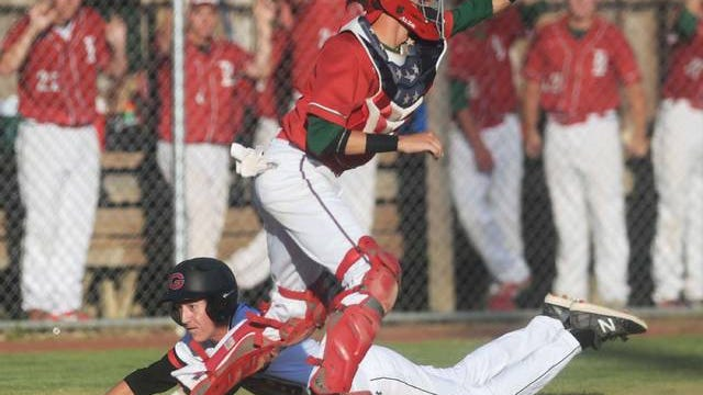 Boone's catcher Dylan Bangs catches the late throw ball as Gilbert's Owen Blumhagen slides safely for a score during the first inning in the class 3A baseball sub-state final at Gilbert High School on Wednesday in Gilbert. Photo by Nirmalendu Majumdar
