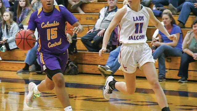 Columbia Central's Janiyha Riley (15) brings the ball into the frontcourt against Lincoln County's Alyssa Sticker during Friday's District 8-AAA contest. After stopping a 54-game district losing streak Tuesday, the Lady Lions dropped a 47-43 decision in Fayetteville.
