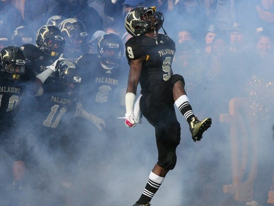Najee Clayton leads his Paramus Catholic High School team out onto the field in 2013.