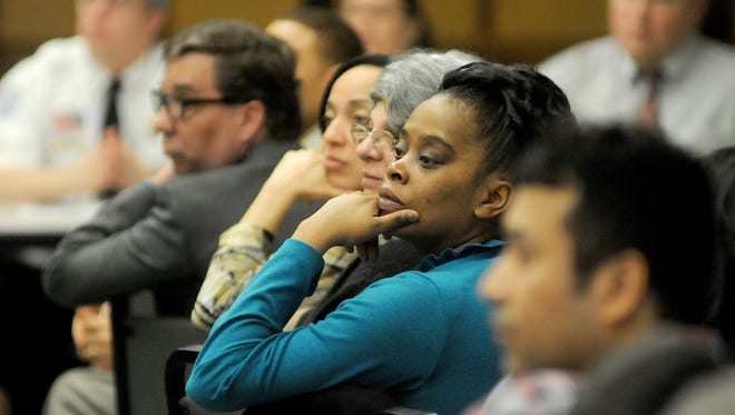 Concerned residents and local dignitaries listen during the Mend Mansfield Coalition meeting Tuesday at Mount Calvary Baptist Church.