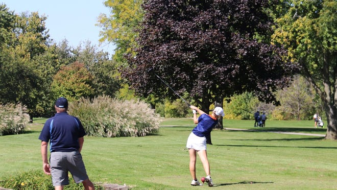 Pontiac Township High School junior Dani Grace Schrock follows through with her tee shot on the 12th hole at the Elks Club Golf Course Wednesday afternoon. Schrock was participating in the Pontiac Regional girls' golf tournament on the course that was ablaze with brilliant fall colors on display.