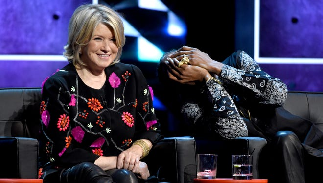 Martha Stewart, left, and Snoop Dogg have a laugh at the Justin Bieber roast.