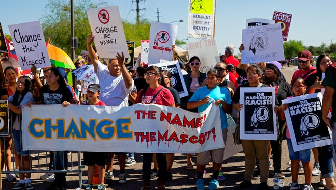 Oct 12, 2014; Glendale, AZ, USA; Native American indians protest the Washington Redskins name prior to the game against the Arizona Cardinals at University of Phoenix Stadium.