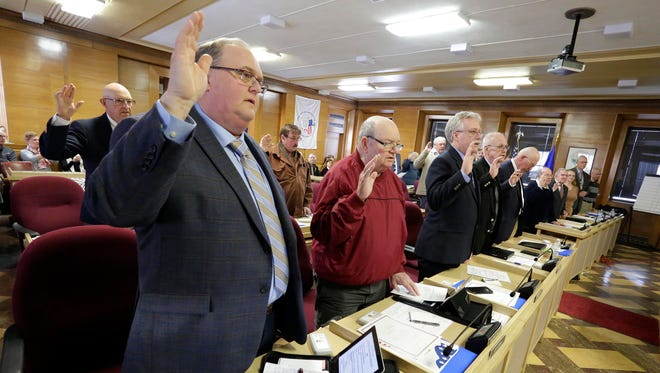 Sheboygan County Board members are sworn in, Tuesday, April 17, 2018, in Sheboygan, Wis.