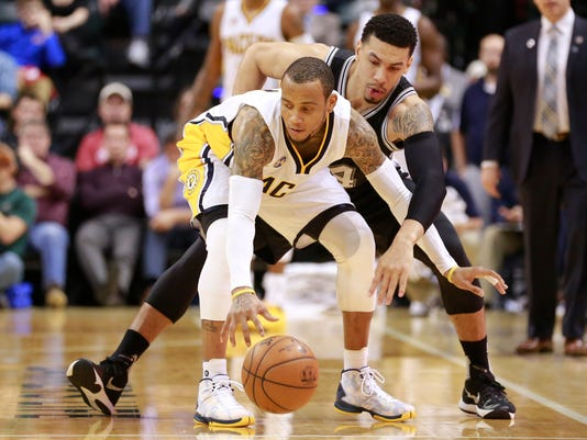 Indiana Pacers guard Monta Ellis, left, keeps the basketball away San Antonio Spurs guard Danny Green in the second half of an NBA basketball game, Monday, March 7, 2016, in Indianapolis. Indiana won 99-91. (AP Photo/R Brent Smith)