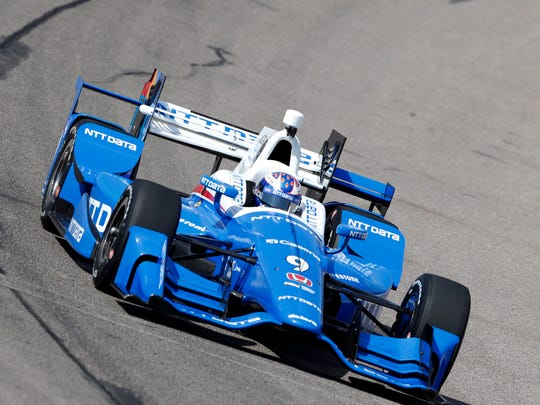 Scott Dixon, shown driving during practice at Iowa Speedway, noted at the end of the race that his car was so hard to handle that he was happy his day didn't end in a wreck.