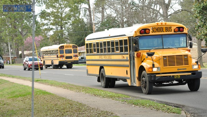 Rapides Parish school buses drop off Acadian Elementary students after school.