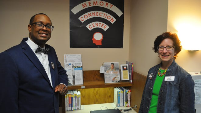 Bashir Easter, a dementia care specialist with the Milwaukee County Department of Aging, shows off the new Memory Connection Center resource desk at North Shore Library along with Julie Hyland, the director of the Wisconsin Music and Memory organization.