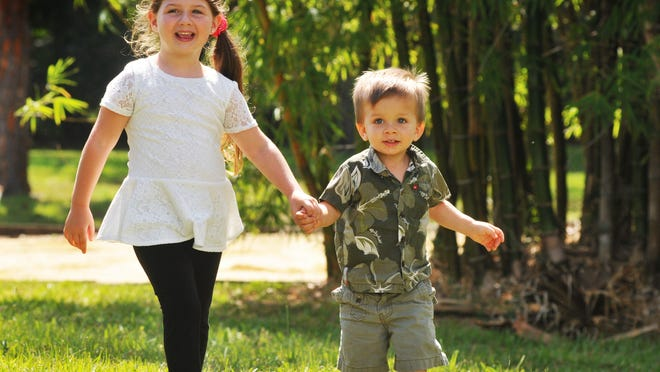 Glenda Rigby's children, Sarah and Sonny, play on the grounds at the Healthy Start Coalition of Brevard office in Rockledge.