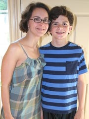 """Amy Mackin at home with her older child, Andrew, age 13 at the time, September 2014, """"with him just about to outgrow me."""""""