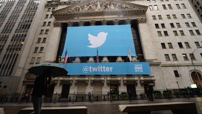 This file photo taken on November 7, 2013, shows  a banner with the logo of Twitter  on the front of the New York Stock Exchange (NYSE) in New York.   Twitter announced plans October 27, 2016 to cut nine percent of its workforce as the struggling social network reaffirmed its strategy to drive growth after failing to find a buyer.
